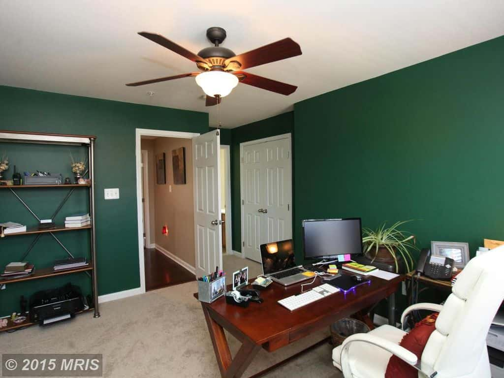 Traditional Home Office With Ceiling Fan Light, Green Walls, Freestanding  Shelf And Carpet Flooring.Source: Zillow Digs