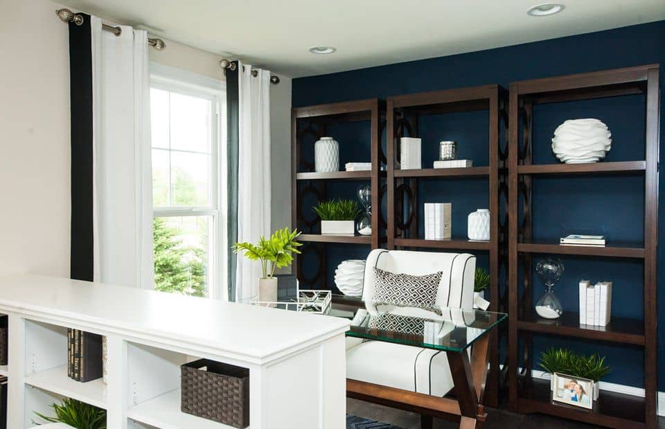 home office with white and blue walls and glass tablezillow digs