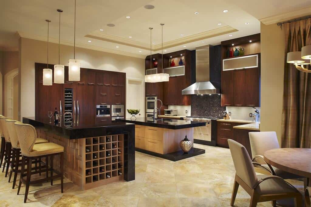 Modern dine-in kitchen in u-shape with tray ceiling, pendant lighting and cube wine rack.