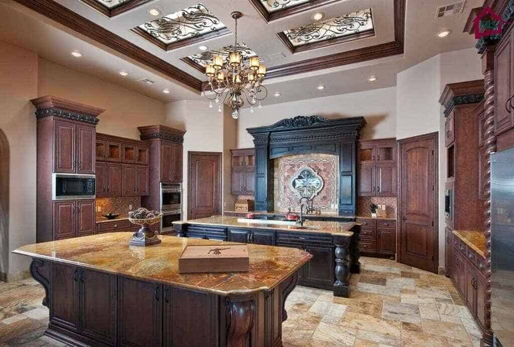 Mediterranean kitchen with tray ceiling, chandelier and 2 islands.