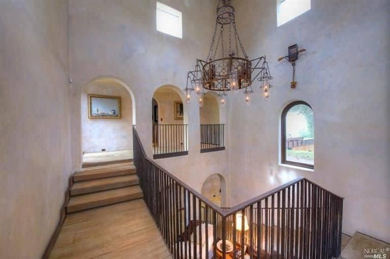 This second floor landing offers a Mediterranean style hallway.
