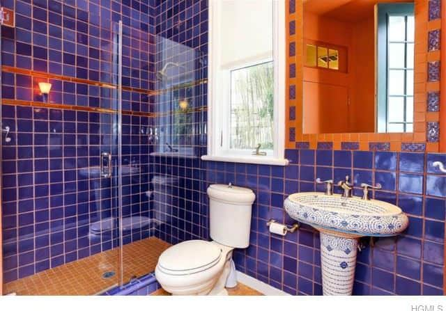 Purple Mediterranean powder room with mosaic pedestal sink.