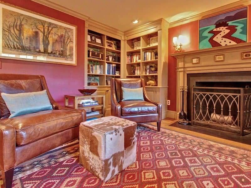 Amazing Eclectic Family Room With Pink Walls, Built In Shelving And A Fireplace.