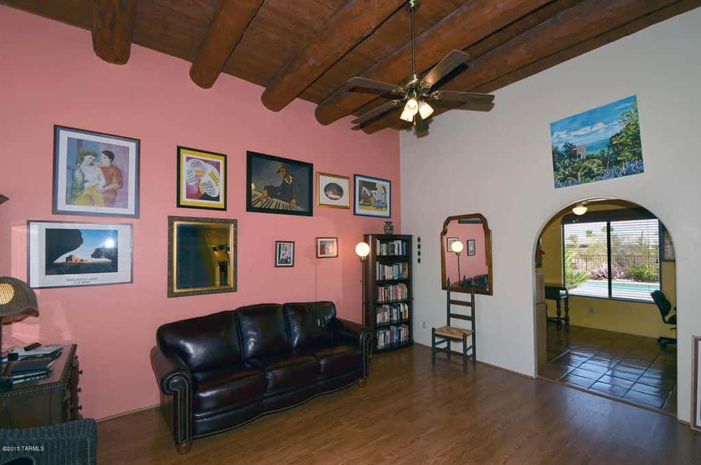Large Southwestern Living Room With Beam Ceiling, Ceiling Fan Light, Arched  Doorway, Hardwood