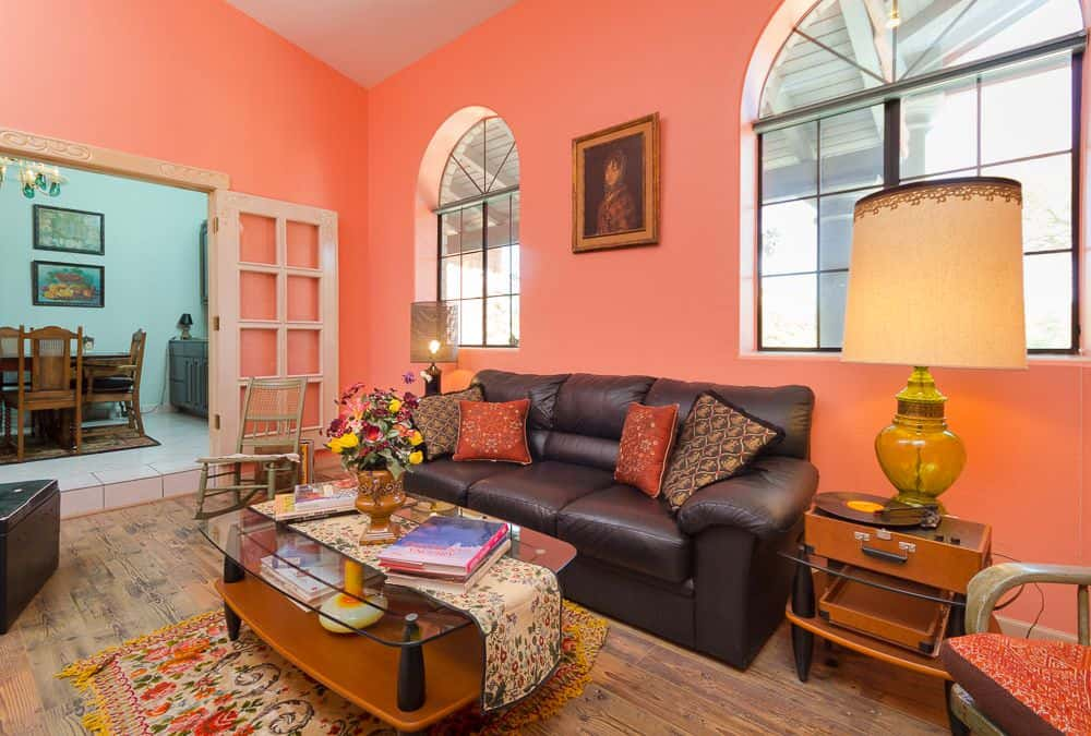 Traditional Living Room With Cove Ceiling Chandelier Pink Walls And Carpet FlooringSource Zillow Digs