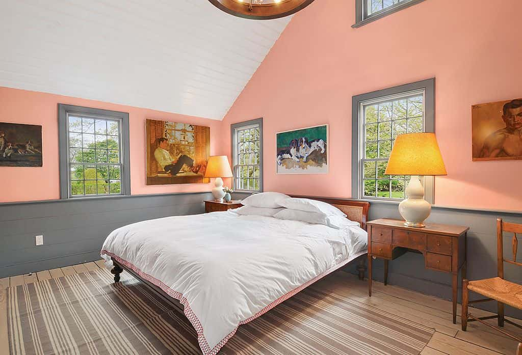 Large Country Style Master Bedroom With A High Ceiling Pink Walls Gray Wainscoting And