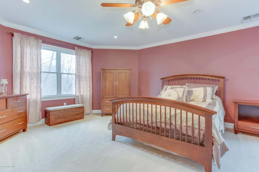 Large Craftsman Master Bedroom With Ceiling Fan Light Pink Walls And Carpet Flooring