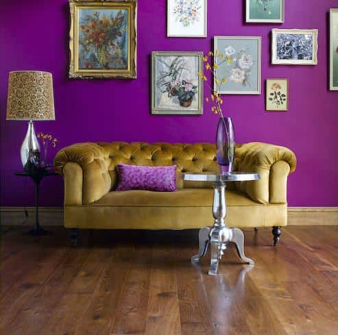 Eclectic Formal Living Room With Hardwood Flooring And A Purple Wall  Featuring An Assortment Of Framed Flower Portraits.Source: Zillow Digs