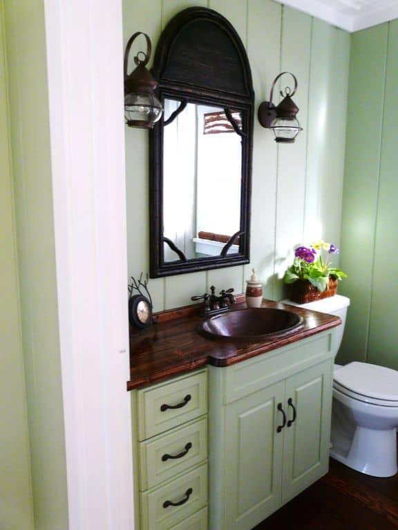 Shabby-chic powder room with undermount sink.