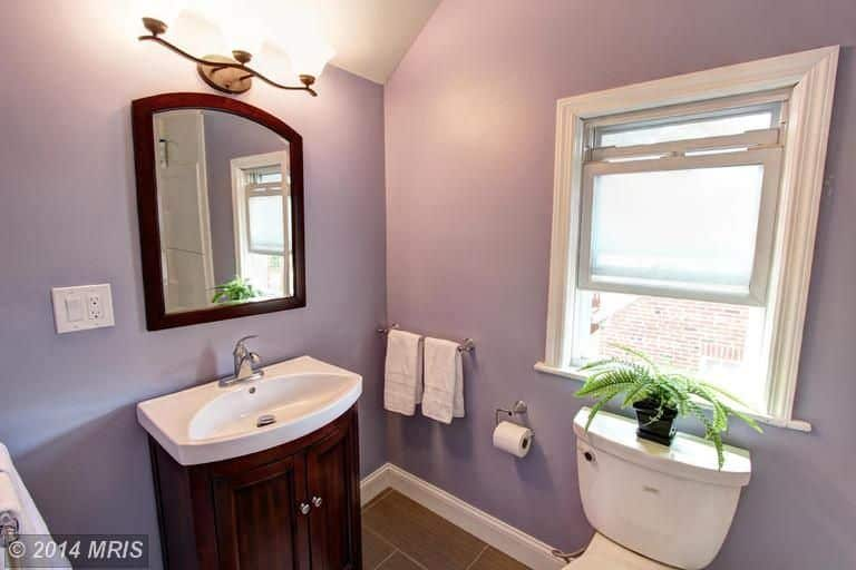 Purple Traditional powder room with single undermount sink and a single-hung window.