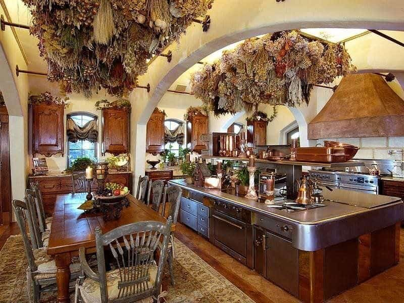 Rustic Kitchen Design With Large Rustic Island With Stainless Steel Counter  Top.