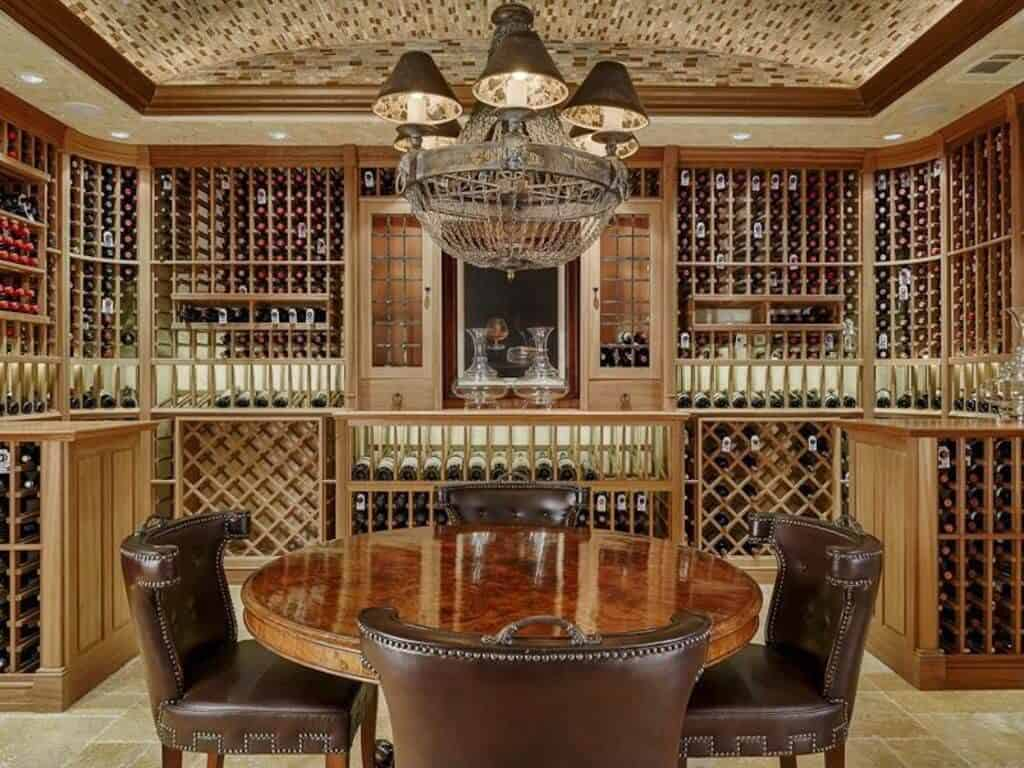 Fabulous wine tasting room with extensive custom cabinets that holds thousands of bottles. The room includes a round table that accommodates four people.