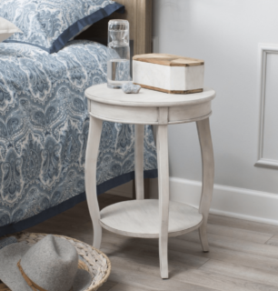 White compact round accent table with lower and upper shelf