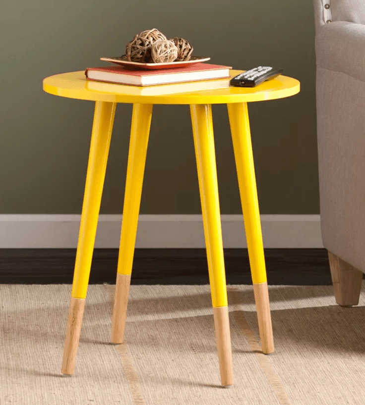 Colorful yellow compact round accent table for the living room.