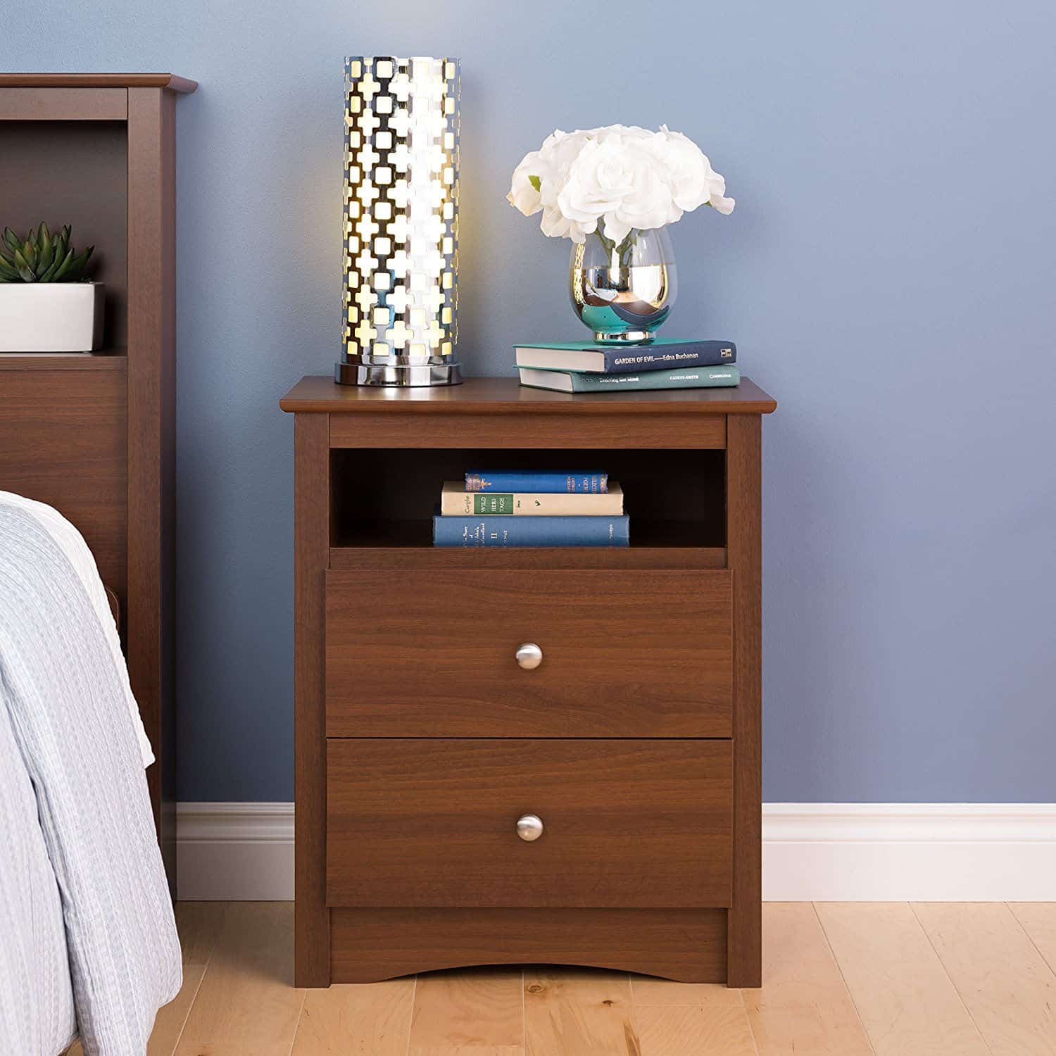 Small wood bedside table with drawers and a shelf.