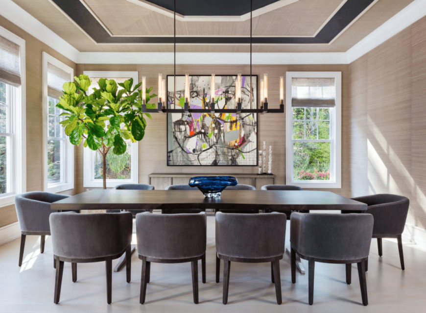 A large potted plant brings a refreshing ambiance to this beach dining room with round back chairs and dark wood dining table topped with a gorgeous decorative bowl.
