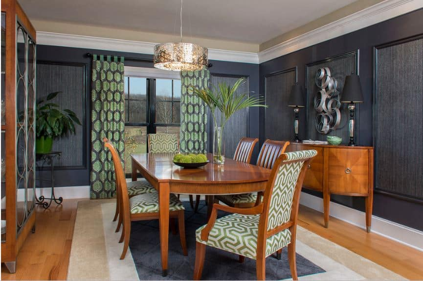 The beige ceiling is surrounded by white molding that contrasts the black walls that are accented with a pair of green patterned curtains that flank the window.