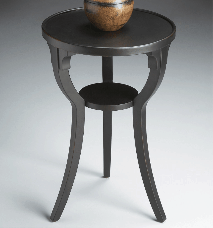 Small black round accent table.