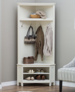 Corner hall tree with shoe storage below and shelving above.