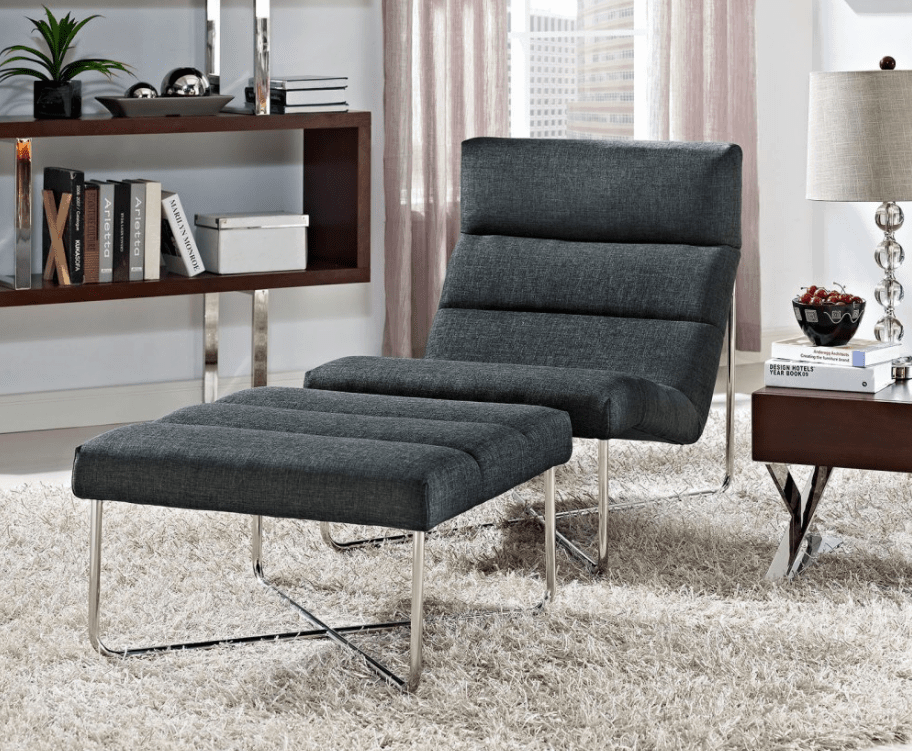 Modern grey accent chair with chrome legs and matching ottoman