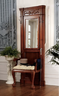Hall tree with built-in chair and arms.