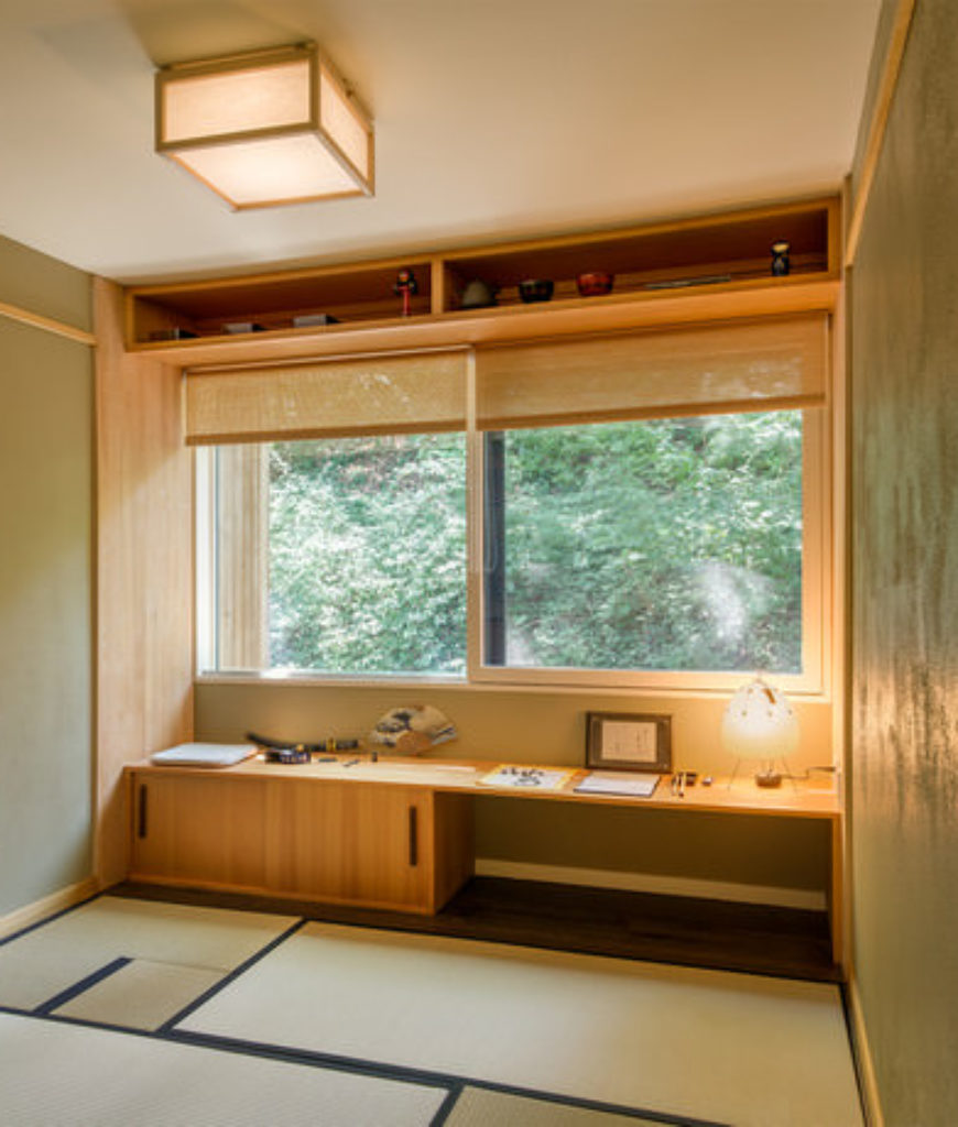Asian home office with glass window and matted floor.