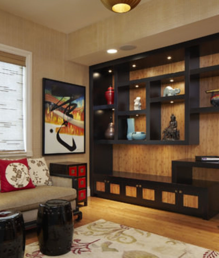 Asian home office with hardwood floor and built-in shelf.