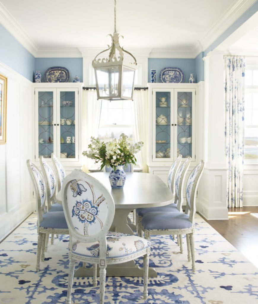 Beach dining room with blue and white walls along with regular ceiling.