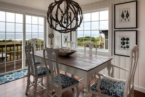 Beach dining room with white walls and beautiful pendant light.