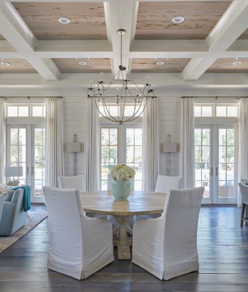 Beach dining room with white walls and white beams ceiling.