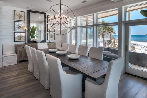 Merveilleux Beach Dining Room With Unique Chandelier And Glass Windows And Door.