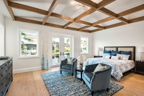 Cozy Master Bedroom In White With Coffered Ceiling, Blue Themed Furniture  And Accessories And Light Wood Flooring.Photo By BUILD   More Bedroom Ideas