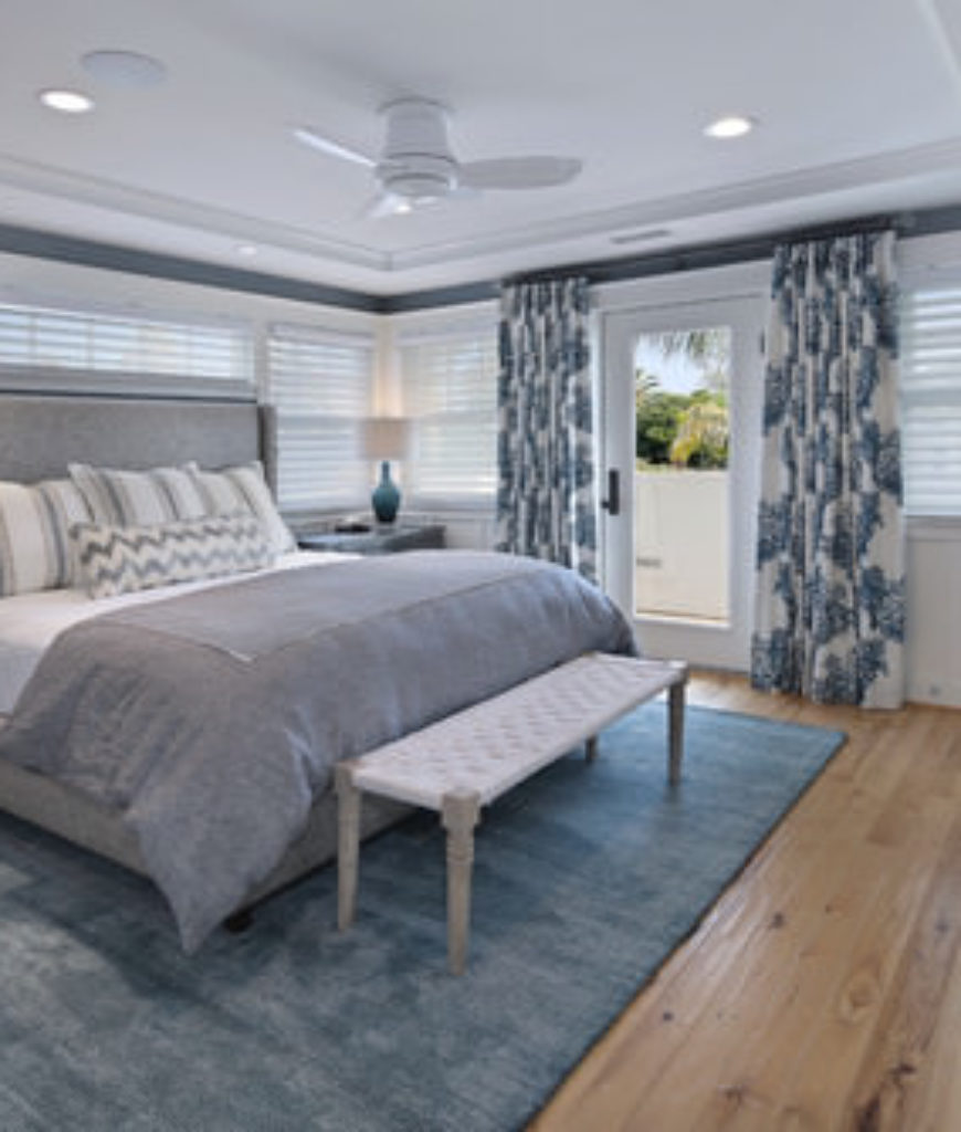 Mid-sized bedroom in white and gray with a soft sophisticated coastal look.