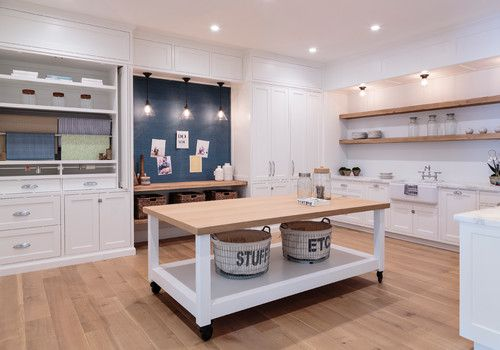 Beach style white crafts room with hardwood flooring and recessed ceiling lights.