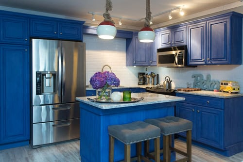Mid Size Beach Style Kitchen With Blue Raised Panel Cabinets, White Subway  Tile Backsplash, Track And Pendant Lighting, Stainless Steel Appliances And  ...