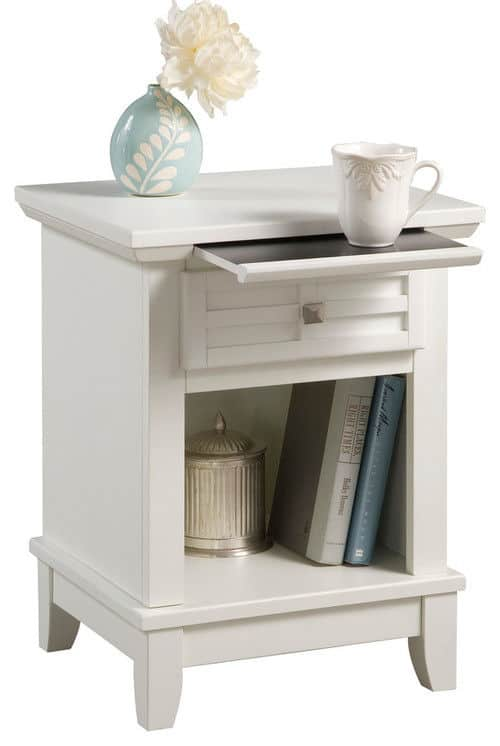 Home styles furniture arts and crafts nightstand with a beautiful scratch and stain resistant finish on the top of the hidden pull-out tray.