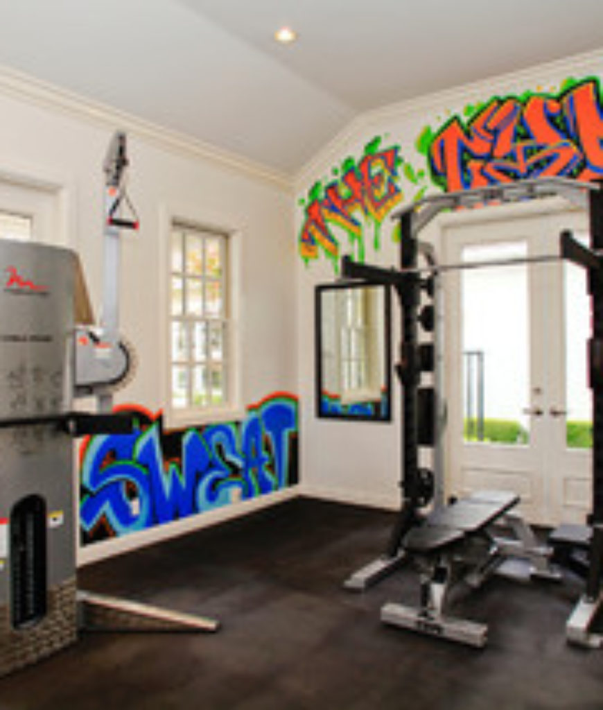 Eclectic home gym with tiled floor and white walls.