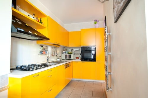 Contemporary Orange Kitchen With Tiled Floor And Yellow Storage Cabinets