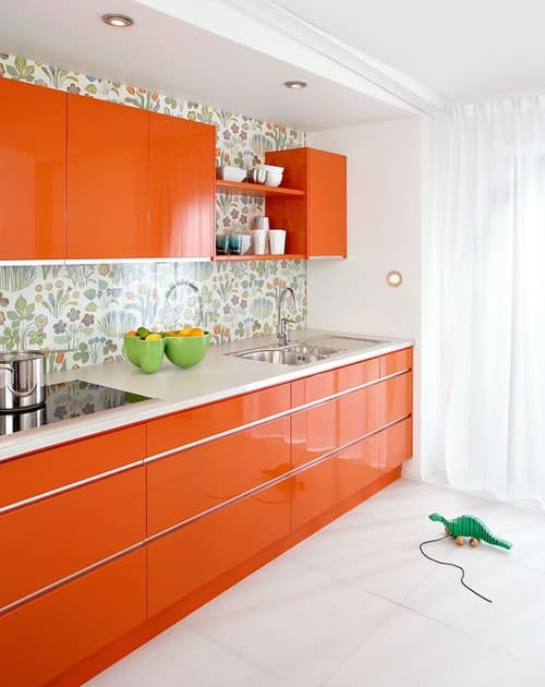 Midcentury Orange Kitchen With Fl Wall Tiles And White Floor