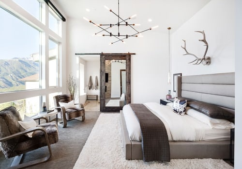Mid Sized Rustic Contemporary Master Bedroom In White With Complex Pendant  Lighting, Carpeted Flooring And Full Fixed Glass Window Overlooking The  Majestic ...