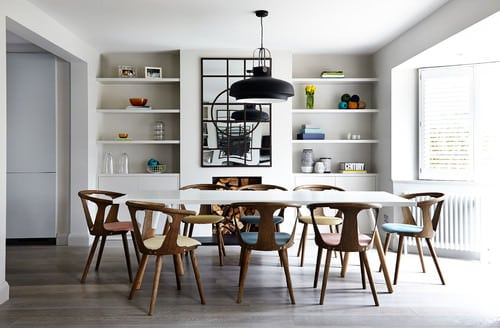 Great Scandinavian Dining Room With Pendant Light And Built In Shelf.