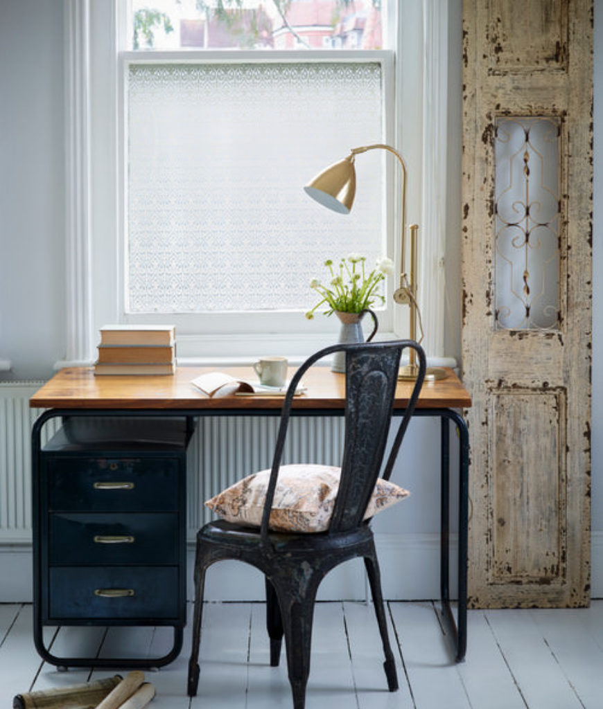 Shabby-chic home office with tiled floor and white walls.