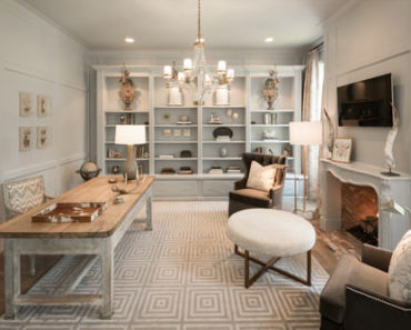Shabby-chic home office with built-in shelf and pendant light.