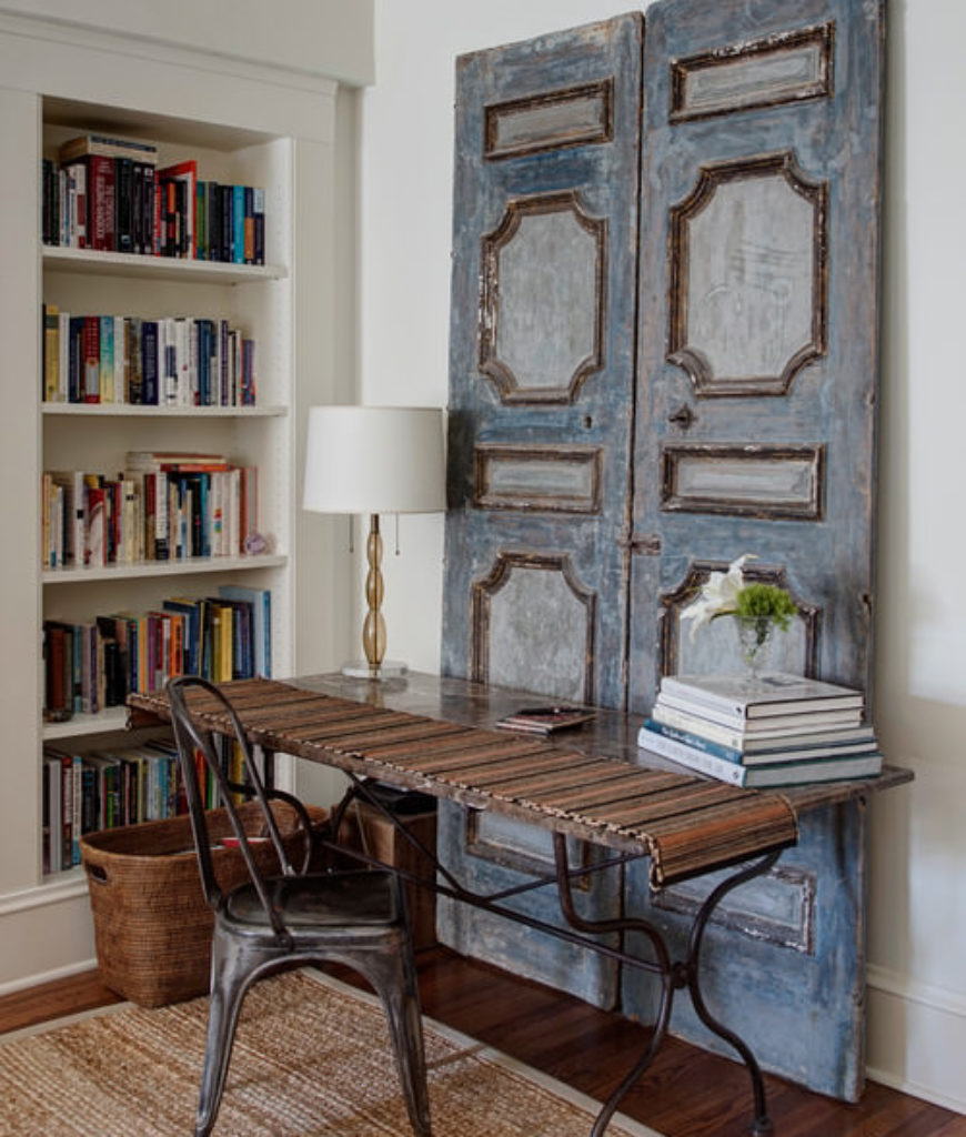 Shabby-chic home office with hardwood floor and built-in shelf.