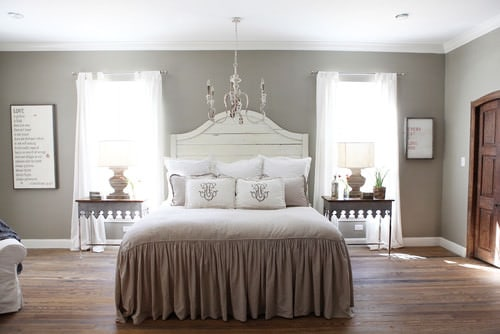 Shabby Chic Master Bedroom With Chandelier And Hardwood Floor