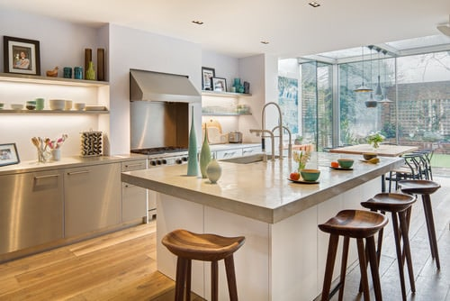Contemporary silver kitchen with center island and hardwood floor.