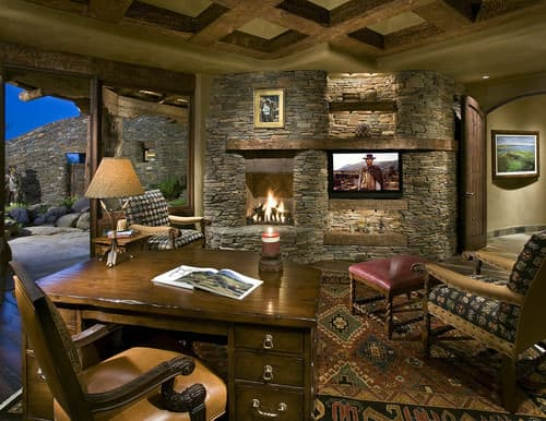 Southwestern home office with wooden table and carpeted floor.