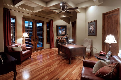 Southwestern home office with coffered ceiling and hardwood floor.