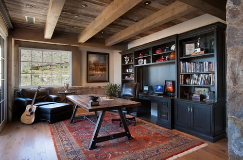 Southwestern Home Office With Wooden Beams Ceiling And Built In Desk And  Shelf.
