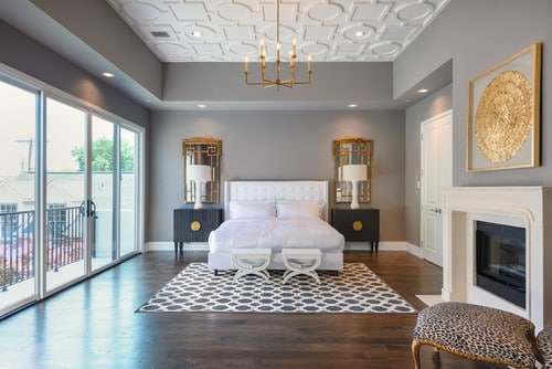 Transitional Master Bedroom With Chandelier Hardwood Floor Wiith Rug And White Bed Photo By Taa Custom Homes More Ideas